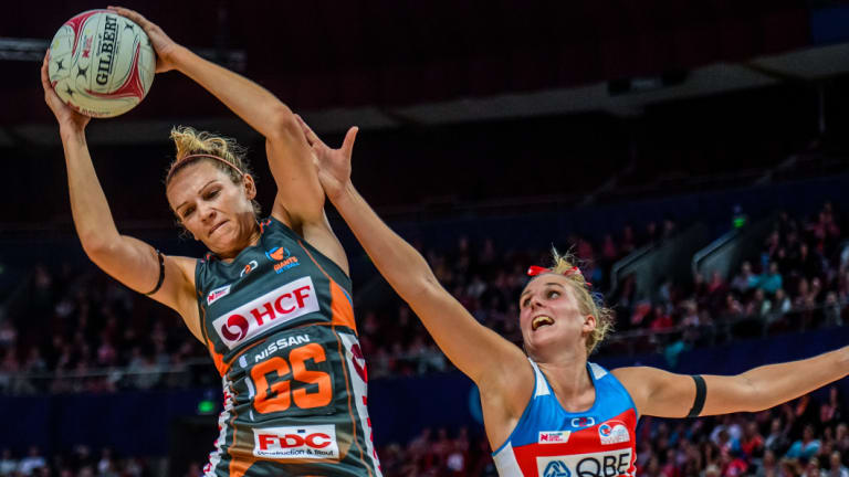Full stretch: Jo Harten of the Giants competes for possession against Maddy Turner of the Swifts at the Qudos Bank Arena.