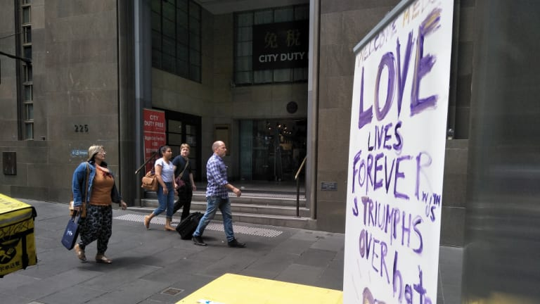 A defiant banner outside City Duty Free, near the scene of Friday afternoon's attack.