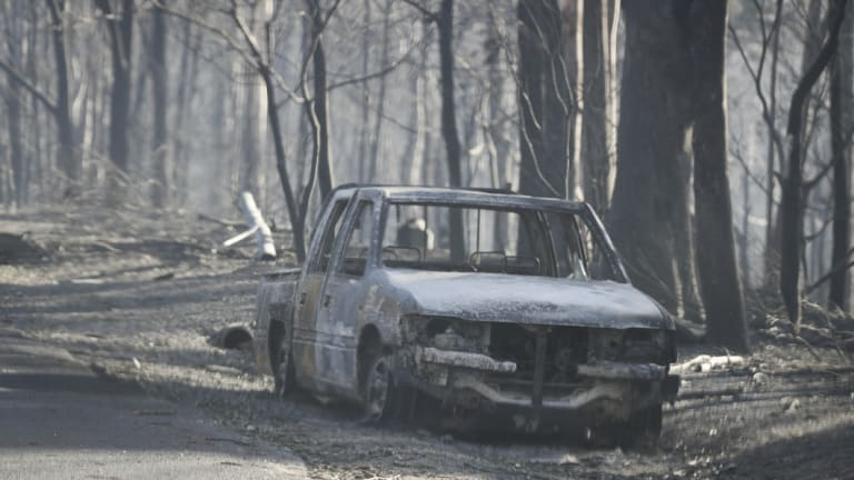 Burnt out car during the Tathra bushfire on the NSW south coast