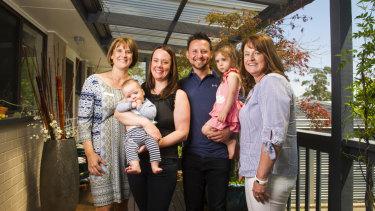 Midwife Ann Clark, Susie Shadmaan with Leo, 4 months, Obi Shadmaan with Eva, 2, and midwife Chrissie Foy.