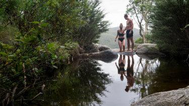 Madi Curry of Richardson and Stuart Dix of Gilmore cooling off at Gibraltar Falls. Photo Elesa Kurtz
