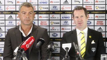 Awkward: Mark Rudan (left), in a file photo alongside Phoenix GM David Dome, is fuming about their fixture switch.