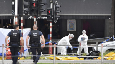 Forensic police investigate at the scene of the shooting.