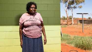 Carer Dadu Gorey outside her home in Yuendumu. Her husband, Victor Ross, is on dialysis.