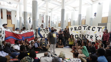 Protestors against fracking in the marble foyer of Parliament House in Canberra.