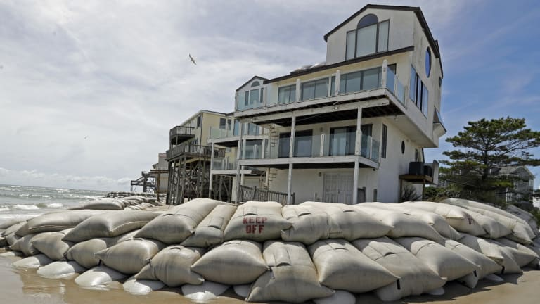 Sand bags surround homes on North Topsail Beach, NC.