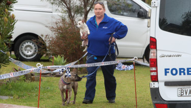 Dogs in the care of victim Kristie Powell were removed from the home on Friday morning.