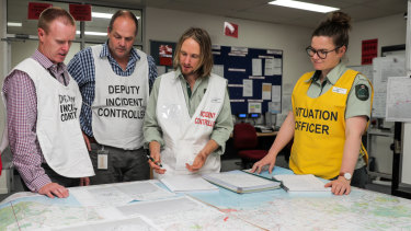 Environment Department incident controller Tim Gazzard (second from right) talks to his team during last year's nurdle emergency in Warrnambool.