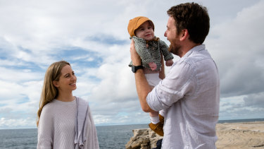 """""""Everything he's faced so far, he's faced with a smile. He's my hero"""": Adam and Alice Mitchell, with baby Spencer."""