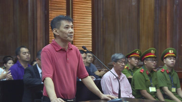 Michael Nguyen stands during his trial in Ho Chin Minh City, Vietnam.
