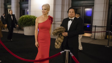 Kellyanne Conway and her husband, George, arrive for a dinner at Union Station in Washington, the day before Trump's inauguration in 2017.