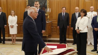Josep Borrell at his swearing in ceremony at the Zarzuela Palace in Madrid in June. King Felipe VI is immediately behind him.