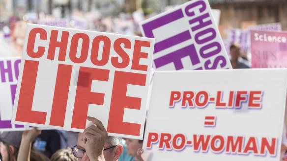 Brisbane rally against abortion decriminalisation laws attracts thousands