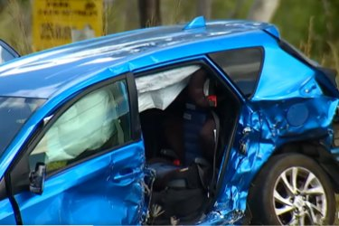 A child has died and another remains in a critical condition after a two-vehicle crash.