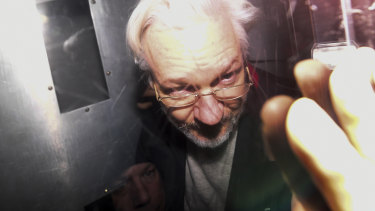 Julian Assange leaves in a prison van after appearing in a London court last year.