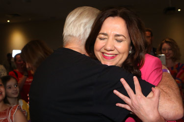 Annastacia Palaszczuk shares a hug with her father, former Labor minister Henry Palaszczuk, after winning her third term as Queensland premier.