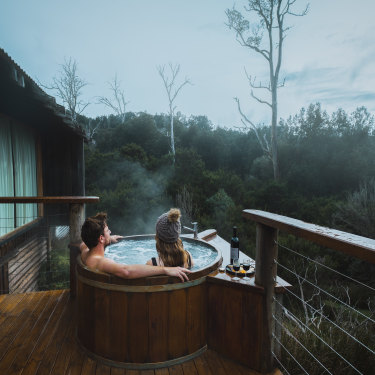 Enjoy a hot tub and cool climate wine against a backdrop of abundant natural beauty at Tasmania's Cradle Mountain Lodge.