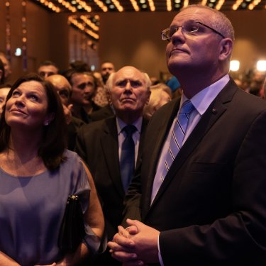 Prime Minister Scott Morrison and former prime minister John Howard watch Labor leader Michael Daley concede defeat in the Sofitel Wentworth on Saturday night.