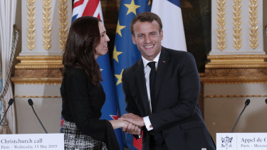 New Zealand Prime Minister Jacinda Ardern, left, and French President Emmanuel Macron, shake hands after the Christchurch Call press conference at the Elysee Palace, in Paris.