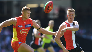 Up for grabs: Gold Coast's Peter Wright and St Kilda's Darragh Joyce battle for possession.