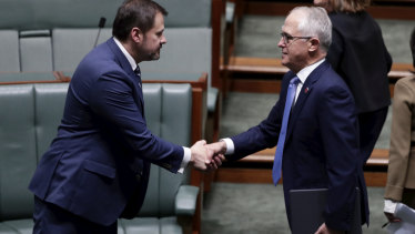 Labor MP Ed Husic and Prime Minister Malcolm Turnbull shake hands on Wednesday.