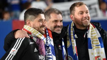 Arthur Papas celebrates Yokohama F. Marinos' title win last season with Ange Postecoglou and Peter Cklamovski, who now coaches Japanese rivals Shimizu S-Pulse.