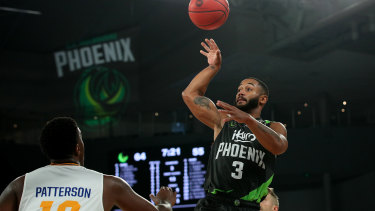 Shooting star: Phoenix import John Roberson in action against the Bullets at Melbourne Arena.
