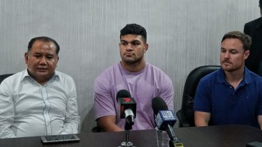 David Fifita (centre) speaks after being released from a Balinese prison flanked by lawyer Muhammad Rifan and Broncos staffer Adam Walsh.