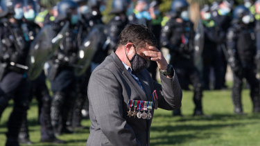 """A man visibly upset at the Shrine. Victoria Police Deputy Commissioner Ross Guenther said it was """"completely disrespectful"""" the protesters gathered there."""