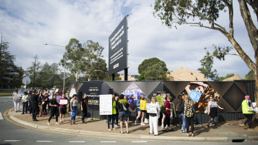 Unions ACT protest about Geocon's sexualised advertising outside Geocon's building site for Tryst.