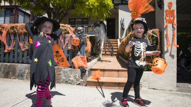 A Halloween haven: Edward Fuzes and Anna Brandweiner, both aged 4, on Third Avenue in Willoughby.