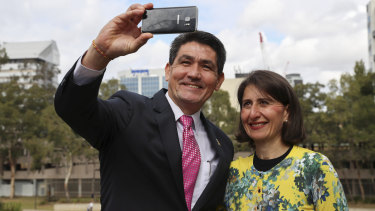 The member for Parramatta, Geoff Lee, takes a selfie with NSW Premier Gladys Berejiklian at an announcement of the site of the Powerhouse Museum in Parramatta on Saturday.