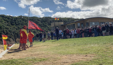 Port Campbell SLSC pauses for a minute's silence  after the drowning deaths of rescue volunteers Ross and Andrew Powell.