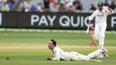Australia's Travis Head reacts after dropping a catch off India's Ajinkya Rahane, right, on Sunday.