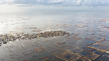 Ganvie, a town in West Africa's Benin seemingly built on a lake surrounded by a grid of artificial fisheries.