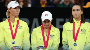 Alicia Molik, Ash Barty and Ajla Tomljanovic of Team Australia after the Fed Cup final.