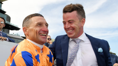 Opie Bosson celebrates in Te Akau silks with trainer Jamie Richards.