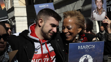 Sex abuse survivor Alessandro Battaglia is hugged by survivor and founding member of the ECA (Ending Clergy Abuse), Denise Buchanan, right, during a march in Rome on Saturday.