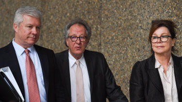 Geoffrey Rush, arriving at court with wife Jane Menelaus on Monday, has hired a third barrister to stop the Daily Telegraph introducing new evidence.