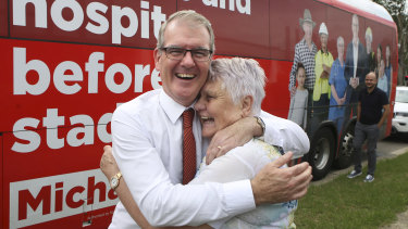 Opposition Leader Michael Daley gets a hug from swinging voter Louise Hollier of  St Clair.