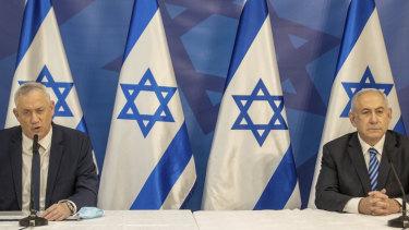 Israeli Prime Minister Benjamin Netanyahu, right, and Israeli Defence Minister Benny Gantz issue a statement at the Israeli Defence Ministry in Tel Aviv, Israel.
