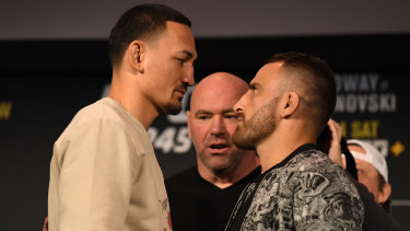 Max Holloway (left) and Alexander Volkanvoski face off during a UFC 245 press conference at Madison Square Garden.