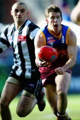 Craig McRae in action for the Lions against Collingwood in the 2003 grand final.
