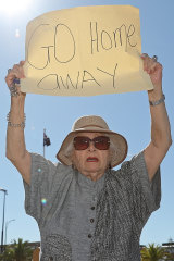 An resident protests as the MSC Magnifica is berthed at the Fremantle Passenger Terminal on Tuesday.