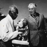 Gurindji leader Mr Vincent Lingiari receives a symbolic handful of soil from Gough Whitlam at a ceremony at Daguragu on August 16, 1975.