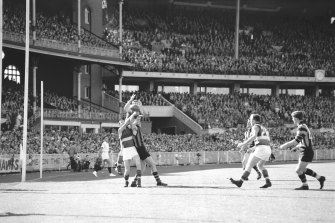 Footscray ruckman rises over Graham Cooper and Graham Ion.