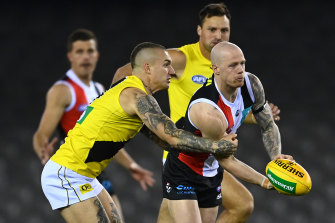 Dustin Martin, left, tackles Zak Jones, right, during the Tigers' round four loss to St Kilda.