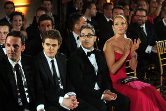 Diverse much?  The 2013 Golden Globes with Paul Wesley, Jason Weinberg and Uma Thurman.