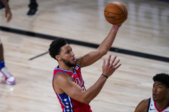 Ben Simmons in action against the Wizards before he left the game with a knee injury.