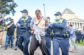 A man is arrested at the anti-lockdown protest at the Shrine of Remembrance.